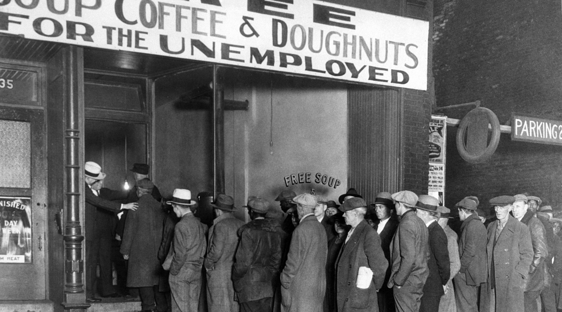 Line of unemployed people for free soup and coffee with donuts